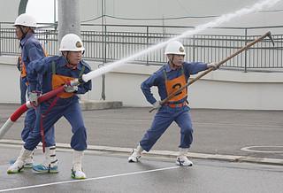 団員不足が指摘されている市消防団。13日行われたに八重山地区消防操法大会の様子(市中央運動公園)