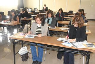 講習会で感染症防止や税務について学ぶ参加者=24日午後、八重山福祉保健所2階会議室