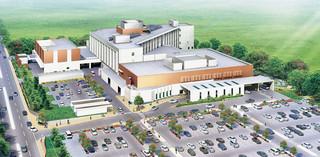 新県立八重山病院のイメージ。施設手前右側が正面玄関。奥の三角部分が病棟で、海が見える病室と山が見える病室がある。左端道路は新空港アクセス道路