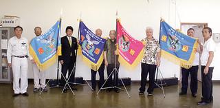 石垣市爬龍船競漕大会のために贈られた優勝旗=18日午後、八重山漁業協同組合2階会議室