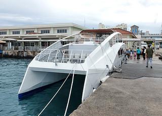8月1日から運航が開始される予定のEV船。双胴船タイプで、船体はアルミ合金でできている=19日午前、石垣港離島ターミナル前