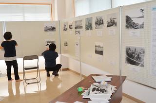 八重山平和祈念館の企画展「沖縄の戦時船舶と尖閣列島戦時遭難事件」に向け準備が進む同館第2展示室=27日午後