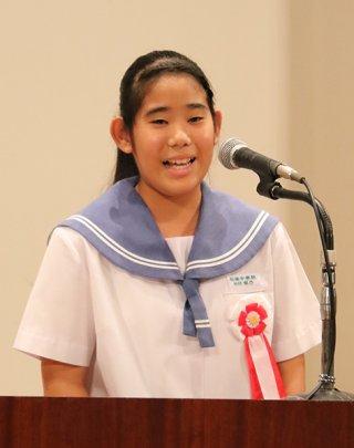 「天使の翼」の演題で発表する松竹梨乃さん。最優秀賞に輝いた